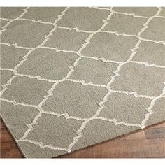 Dhurrie Diamond Soho Trellis Rug: 3 Colors  A durable soho trellis in a classic diamond pattern is chic for any space. The double sided durability of this dhurrie gives it a double life for high traffic areas. 100% wool construction. Featured in today's hottest colors (Taupe, Light Blue, or Coral) Imported. (Specify size and color when ordering)    Product SKU: XR1106 0203TP  Price:  $58.00