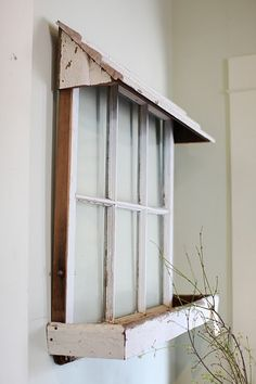 Cute idea to hang an old window, then add a wooden awning and flowerbox. It would look great on the side of a shed or garage! Www.rehouseny.com for salvaged wood and windows