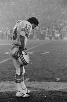 Dan Marino of the Miami Dolphins contemplates defeat in the closing minutes of Super Bowl XIX. His team lost to the San Francisco 49ers 38-16 on January 20, 1985, at Stanford Stadium, Palo Alto, CA.