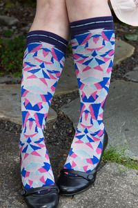Space Fractal Knee High - Scattered, symmetrical shards of time and space (or, pinks and blues) spill up the front of these knee highs. A double cuff with contrast scalloped edges tops it all off.