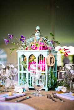 Cute centerpieces. Would look amazing with white lights tucked inside