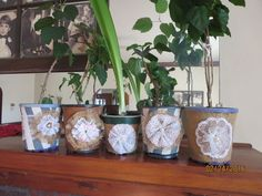 Up-Cycled, Ugly, Black Flower Pots. Wrapped in fabric or burlap with lace flower.