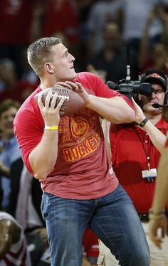 Houston Texans JJ Watt throws a signed ball into the crowd in the second half of Game 2 in the first round of the NBA basketball playoffs at the Toyota Center on Tuesday, April 21, 2015, in Houston. ( Karen Warren / Houston Chronicle ) Photo: Houston Chronicle