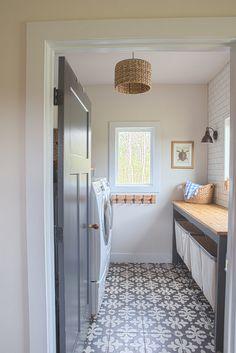 Farmhouse Laundry Room With Grey Interior Door, Grey Custom Folding Doors  And Cement Floor Tile