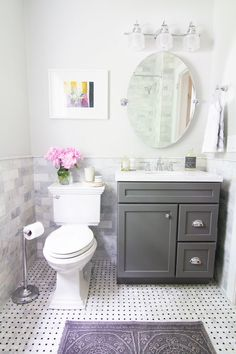 Gray vanity with carera tile. Like the oval mirror.