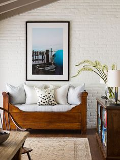 painted brick wall + wood daybed