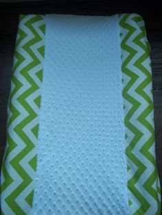 Fitted Changing pad cover, shown in Modern Lime green and white chevron print with white minky center. $26.95, via Etsy.