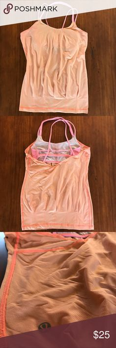 Lululemon Peach Flow & Glow Tank Size Small Lululemon Peach Flow & Glow Tank w/ Pink Trim, Straps, & Built-in Luon Bra Size: 2  Pre-owned and good condition with Minor pink stain on upper left back which is faint (see last photo) lululemon athletica Tops Tank Tops