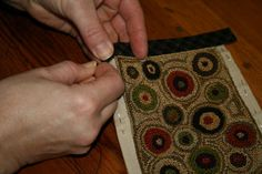 Threads That Bind how to finish the edge of punchneedle - would make a great miniature hooked rug.