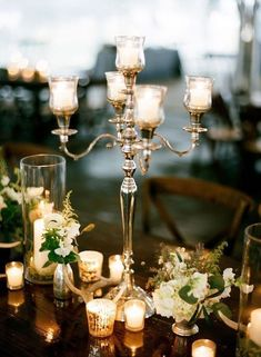 Elegant candelabra centerpiece for a wedding table. wedding centerpieces Wedding Table Centerpieces so Fab You Won't Be Able to Look Away Winter Table Centerpieces, Candelabra Centerpiece, Wedding Table Centerpieces, Decoration Table, Flower Centerpieces, Wedding Decorations, Table Wedding, Wedding Candelabra, Diy Wedding