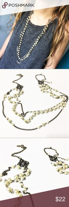 """White House Black Market Long Pearl Necklace This stunning WHBM Long Pearl and brass chain necklace has 3 strands that meet on each side at a beautiful decorative brass piece. Necklace is 36"""" long and in fabulous condition. Questions? Please ask! Sorry, no trades. Bundle for a discount. White House Black Market Jewelry Necklaces"""
