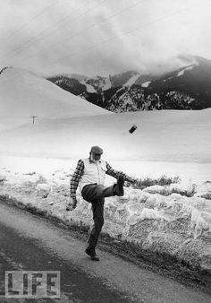 "Photographer John Bryson was on assignment for a magazine other than LIFE -- taking pictures of Ernest Hemingway's wife, Mary, at their Ketchum, Idaho, home -- when he took this photo of Papa kicking a can down the road. ""This was the best picture I ever had taken,"" Hemingway reportedly later told LIFE's editors."
