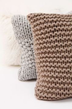Knitted pillow cases in a calm, neutral tone