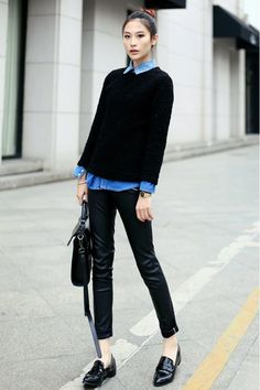 Shop this look on Lookastic:  https://lookastic.com/women/looks/crew-neck-sweater-denim-shirt-skinny-pants-loafers-satchel-bag-watch/13429  — Blue Denim Shirt  — Black Textured Crew-neck Sweater  — Gold Watch  — Black Leather Satchel Bag  — Black Leather Skinny Pants  — Black Leather Loafers
