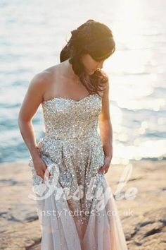 sparkling beaded beach wedding dress, gold sequins overlay tulle beaded on all over bodice and top skirt, strapless sweetheart neckline, A-line silhouette and floor length finished, back zipper up.