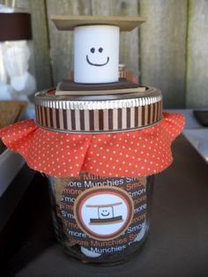 A little foam marshmallow in between brown foam sheets   cut into squares make a cute little topper for the jar