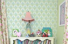 That vintage wallpaper is original to the house. I love how perfect it is for her daughter's vintage infused room! #vintage #curtains #bookshelf