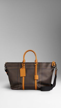 Smoked Check Tote Bag | Burberry $1,150.00 Item 38762491 DARK MARIGOLD         Smoked check tote bag with leather trim         Oversize leather zip pull with padlock closure, leather-covered key         Rolled leather handles, detachable nylon crossbody strap, leather luggage tag         Interior pocket and polished metal hardware         39 x 33 x 18cm         15.4 x 13 x 7.1in         100% PVC with calf leather trim         Imported
