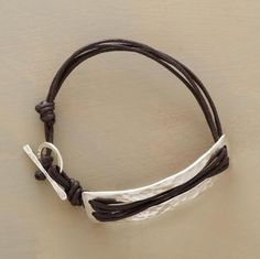 """Leather cords thread across our comfortably curving plaque of hand hammered sterling silver. A handmade exclusive with toggle clasp. Approx. 6-1/2""""L."""