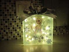 Elsa glass block night light lit made for my granddaughter.     2014