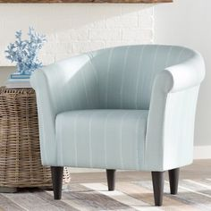 Round out your stylish seating group in a pinch with this beautiful barrel chair. Simply pull it up beside a low-slung sofa for added entertaining space in the den, then roll out a flat-woven rug on the floor below to anchor a clean-lined coffee table where you can serve up impromptu crudites and cocktails at your next casual gathering. Founded upon four tapered feet, its frame is wrapped in polyester upholstery with a versatile solid hue. Searching for something to spruce up the master…