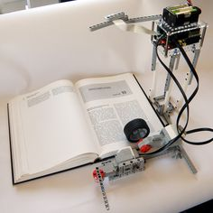 Lego Bookreader: Digitize Books With Mindstorms and Raspberry Pi #arduino ~~~ For more cool Arduino stuff check out http://arduinoprojecthacks.com