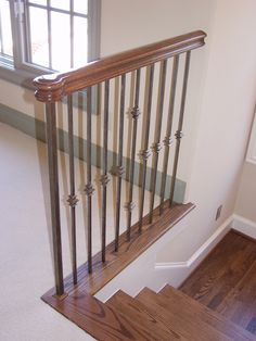 This Staircase Uses High Quality Wrought Iron Balusters To Create A Unique  Transitional Style Design.