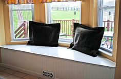 I LOVE window seats! Now I can try to make my own . . . after we have a house, that is.