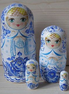 matryoshkas (Russian nesting dolls) in white outfits with blue flowers