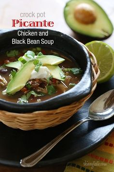 Crock Pot Picante Chicken and Black Bean Soup - Top it with cilantro for freshness and your taste buds will want to do a mariachi dance.