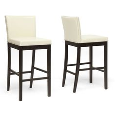 Update the decor in your home bar with these sleek modern bar stools. The set of two stools feature cream-colored faux leather upholstery, dense polyurethane foam filling for added comfort, and black wooden legs that add an elegant touch.