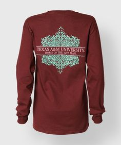 """This longsleeve maroon shirt has a large green flourish on the back with a banner cutout and text that reads """"Texas A&M University, Home of the 12th Man"""". The front has a green block ATM. 50/50 cotton polyblend."""
