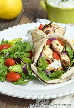 These delicious Chicken Gyros are loaded with tender, most super flavorful grilled chicken, fresh tomato, red onion and wonderful homemade Tzatziki! Seriously better than anything from a Gyro stand. There used to be a little gyro shop a few streets over from me—you know the kind I'm talking about, more like a little food stand …