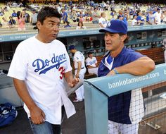 Comedian-actor George Lopez chats with Los Angeles Dodgers manager Don Mattingly before the game against the San Francisco Giants at #DodgerStadium on Aug. 21, 2012  http://celebhotspots.com/hotspot/?hotspotid=6452&next=1