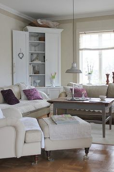 corner hutch in sitting room could use for bedroom linens and books