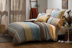 Inspired by traditional Japanese kimono designs, the Misaki quilt cover will add a touch of understated elegance to your bedroom. The warm ochre hues and soft blossom prints combine with calming blue panels to create this serene design. Traditional Japanese Kimono, Single Quilt, Kimono Design, Quilt Cover Sets, Queen Quilt, Bed & Bath, Bed Spreads, Linen Bedding, House Colors