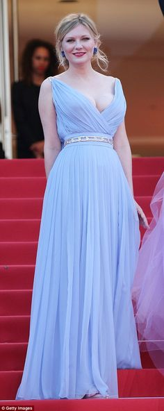 Pastel pair: Kirsten Dunst teases her ample bust in a plunging Grecian-inspired prom gown as her co-star Elle Fanning matches her in a pastel lavender ensemble of the same style... as the pair attend the Cannes premiere of their new film The Beguiled