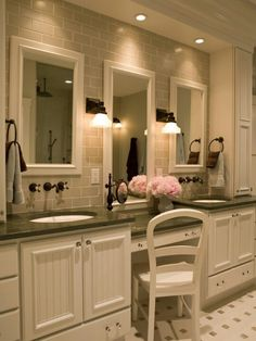 We LOVE this custom-designed master bathroom featuring double vanities, a sit-down make-up counter with a tiled back wall, hanging mirrors and oil-rubbed bronze plumbing fixtures. Description from pinterest.com. I searched for this on bing.com/images