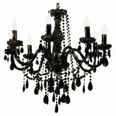 "8-light chandelier with cascading crystal accents and a black finish.  Product: ChandelierConstruction Material: Metal and crystalsColor: BlackAccommodates: (8) 25 Watt B10 incandescent bulb - not includedDimensions: 29.5"" H x 24.375"" Diameter"
