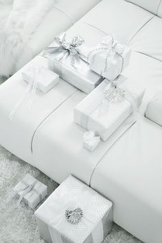 White couch. White gift wrap. Everything in lovely white !