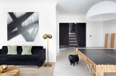 On the terrace level, a custom table tennis set, abstract artwork by daughter Madison and relaxed-yet-refined furnishings bump this family-friendly hangout up an extra grade.