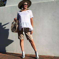 Peplum top, bermuda shorts, booties and sunhat | Photo by Tamera Beardsley (@tamerabeardsley) | For more style inspiration visit 40plusstyle.com