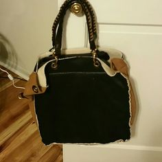 Large tote Large brown, tan and black tote never been used tag still on.  Comes with long strap Bags Shoulder Bags
