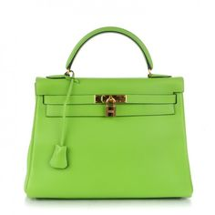 This is an authentic HERMES Veau Gulliver Retourne Kelly 32 in Vert Cru. This Kelly handbag is crafted of smooth calf leather in bright green.