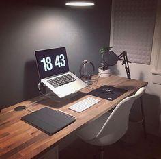 wooden desk, black walls