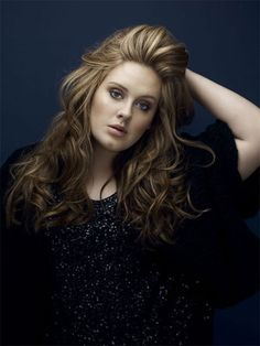 Adele. She Is Just So Amazing! I Love Her Voice And I Love Her Whole vibe. I Think She Is So Beautiful.