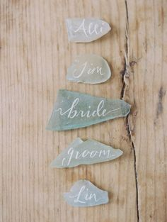 Add some pretty calligraphy to the soft muted tones of sea glass and you have a gorgeous set of place cards. Source: heyweddinglady.com #DIY #beachweddings #placecards