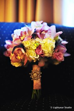 a glamorous bridal bouquet accented with an heirloom brooch via Lightyear Studio