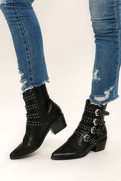 "We're really feeling the look of the Fallon Black Belted Mid-Calf Boots! Kick around in these edgy vegan leather, pointed toe boots with four studded belts (with silver hardware) that accent the mid-calf shaft. 6"" zipper at instep."
