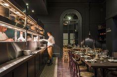 love the strip or long tile 'rug' Open Kitchen Restaurant, Cafe Restaurant, Restaurant Design, Restaurants, Pub Design, Bar Design Awards, Famous Interior Designers, Vintage Cafe, Rocket Stoves